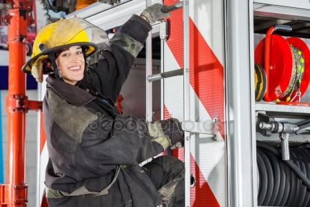 depositphotos_80600878-stock-photo-smiling-firefighter-standing-on-truck.jpg